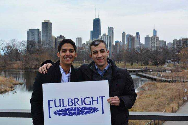 Holding The Fulbright Sign In Chicago With An Algerian Fulbright Scholar