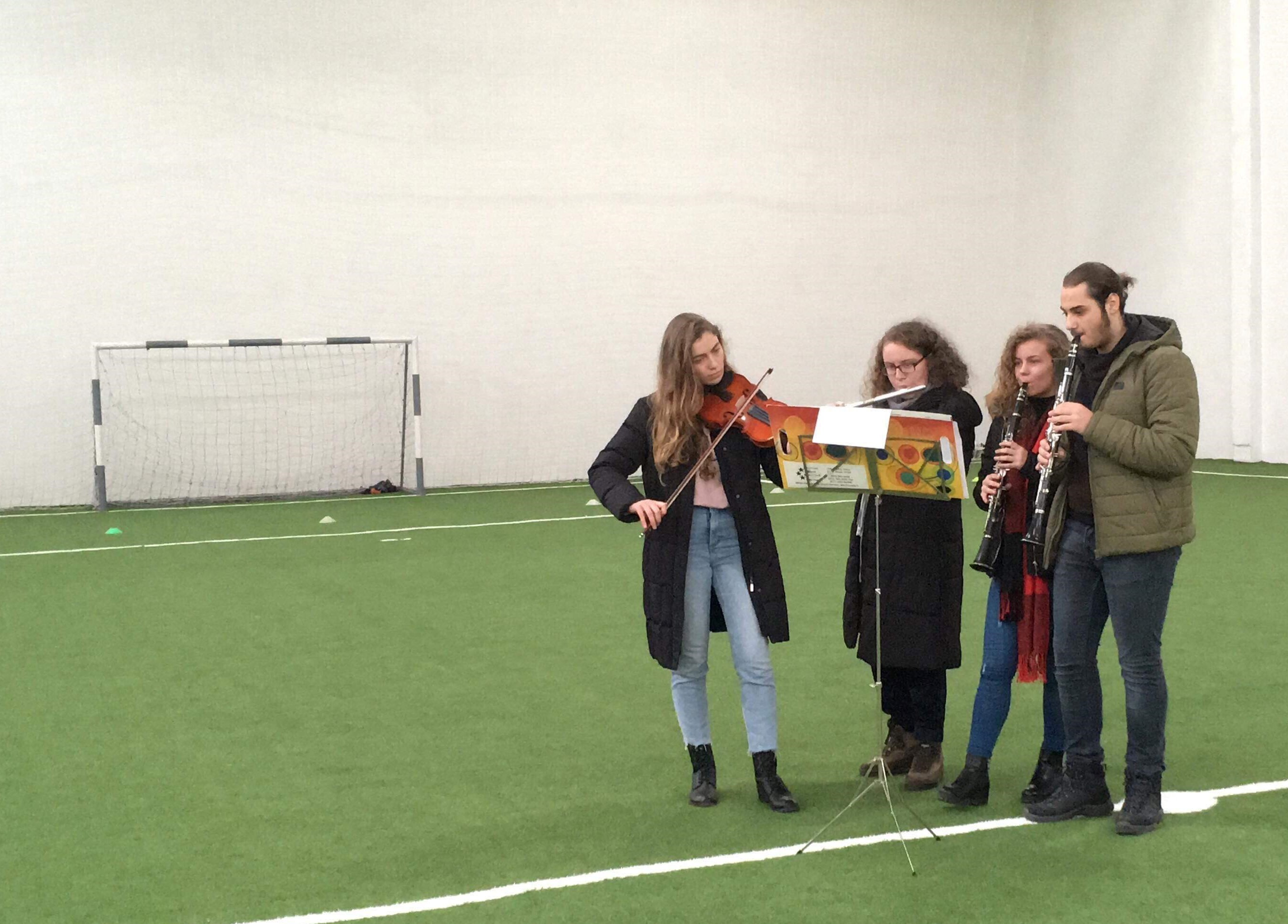 Kosova Behar Bunjaku And Other Students Playing Their Instruments During The Halftime