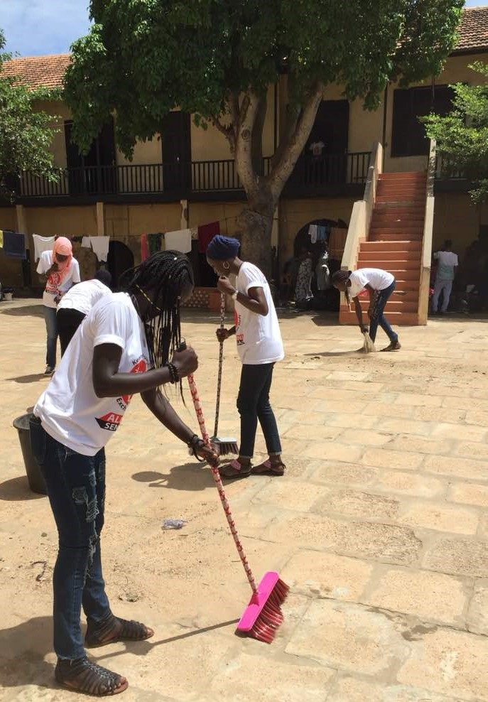 Senegal Dakar Alumnae Cleaning The School Yard At The Re Entry Community Service Activity