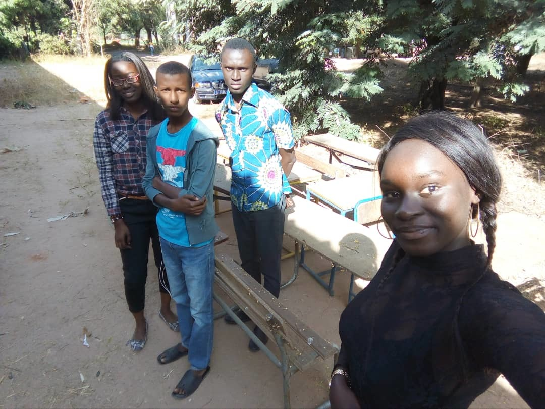 Senegal Ziguinchor Alumna Farma Maiga Yes 15 And 3 Friends Who Helped To Help Pick Up Tables For Classroom Equipment Activity
