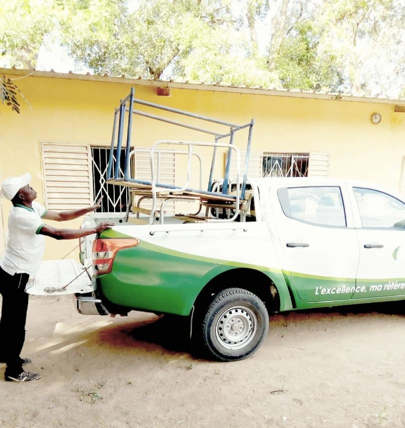 Senegal Ziguinchor Car Provided To Alumna Farma Maiga And Friends By University To Help Pick Up And Transport Tables For Classroom Equipment Activity