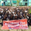 Ina Breaking Stereotypes Large Grp With Banner